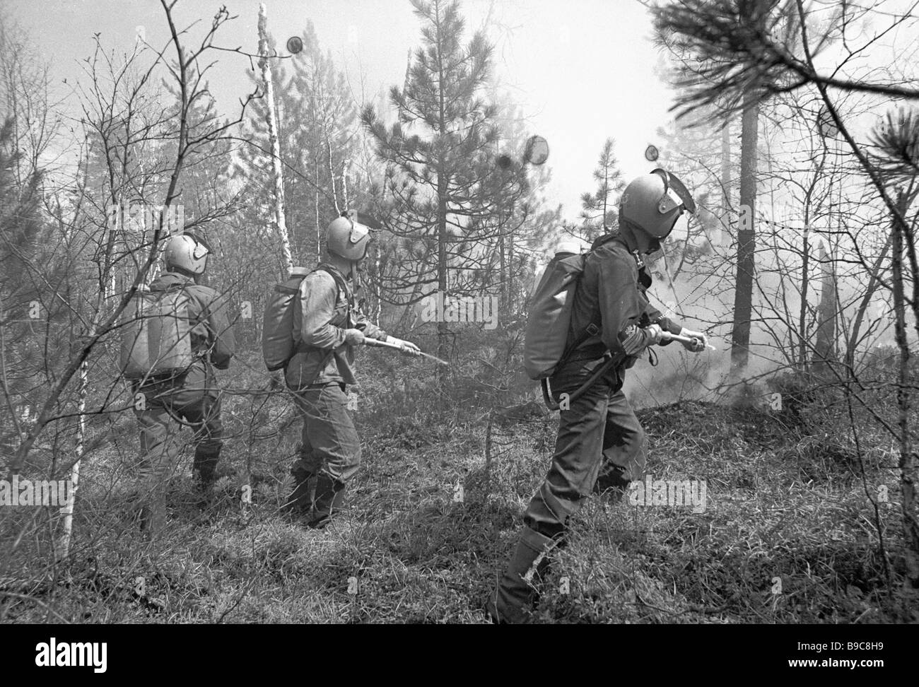 Firemen fight a taiga conflagration - Stock Image