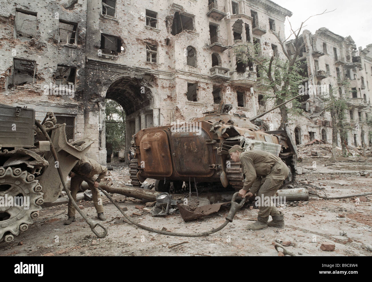 Federal troops getting ready to removed destroyed vehicles from ruined Grozny - Stock Image