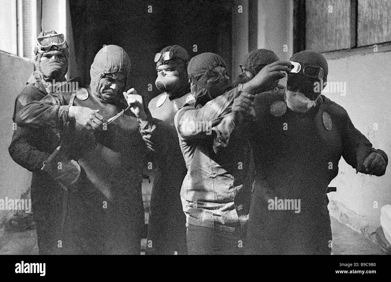 A group of liquidators ready to climb the top of the Chernobyl nuclear reactor after the disaster - Stock Image