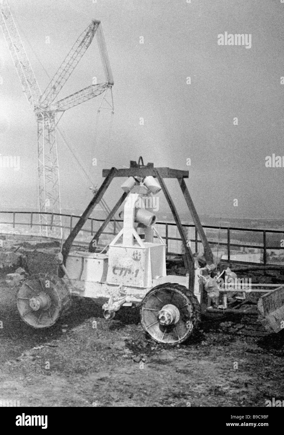A remote control robot clearing the top of the damaged Chernobyl nuclear unit - Stock Image