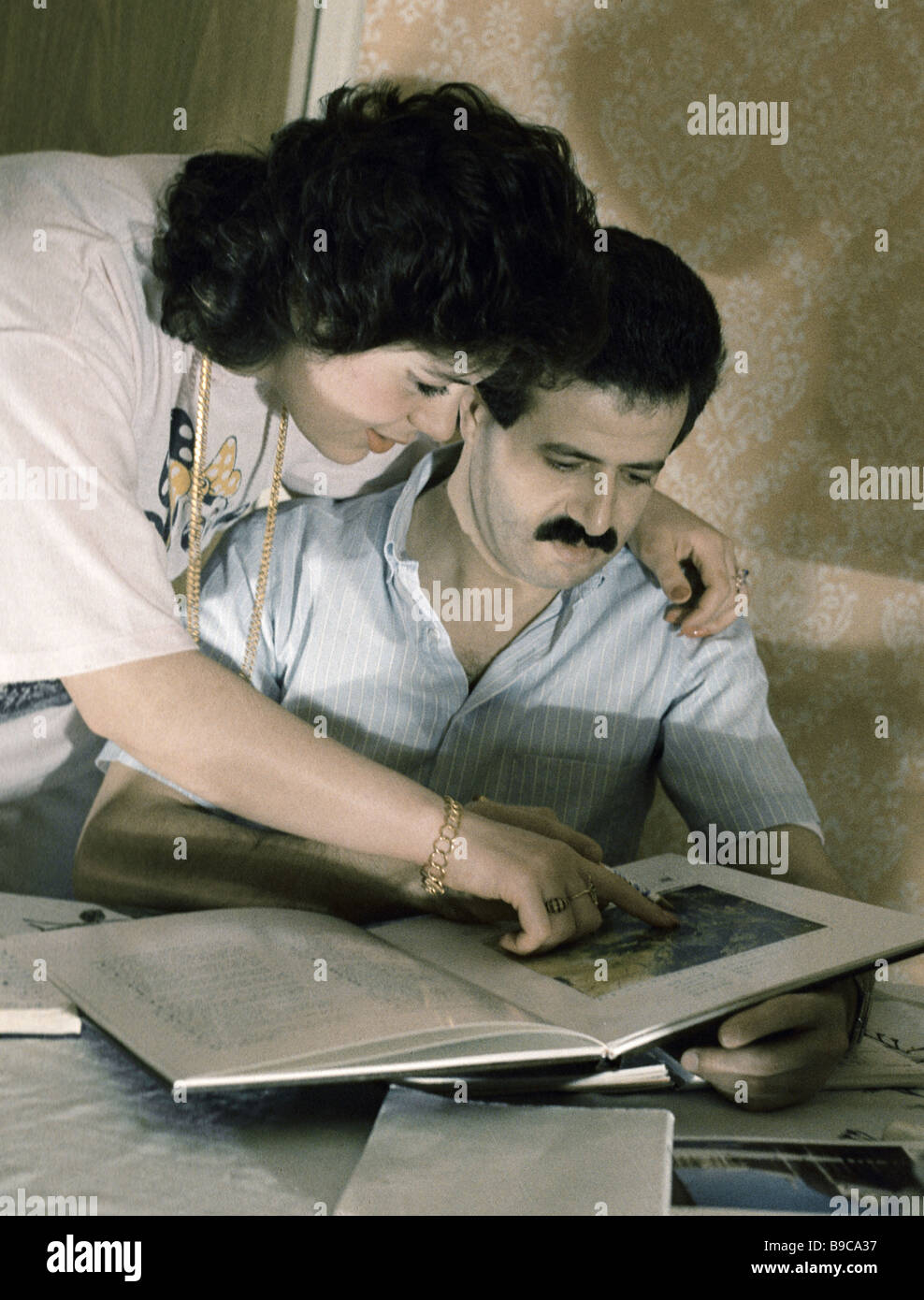 Syrian cosmonaut Muhammed Faris right with wife Grind Akil left - Stock Image