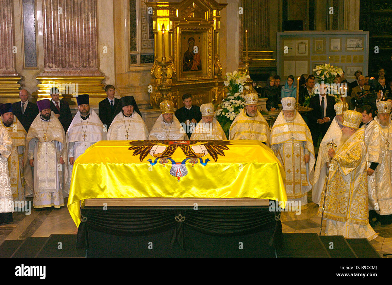 In St Isaac s Cathedral in St Petersburg Patriarch of Moscow and All Russia Alexii II praying for deceased Empress - Stock Image
