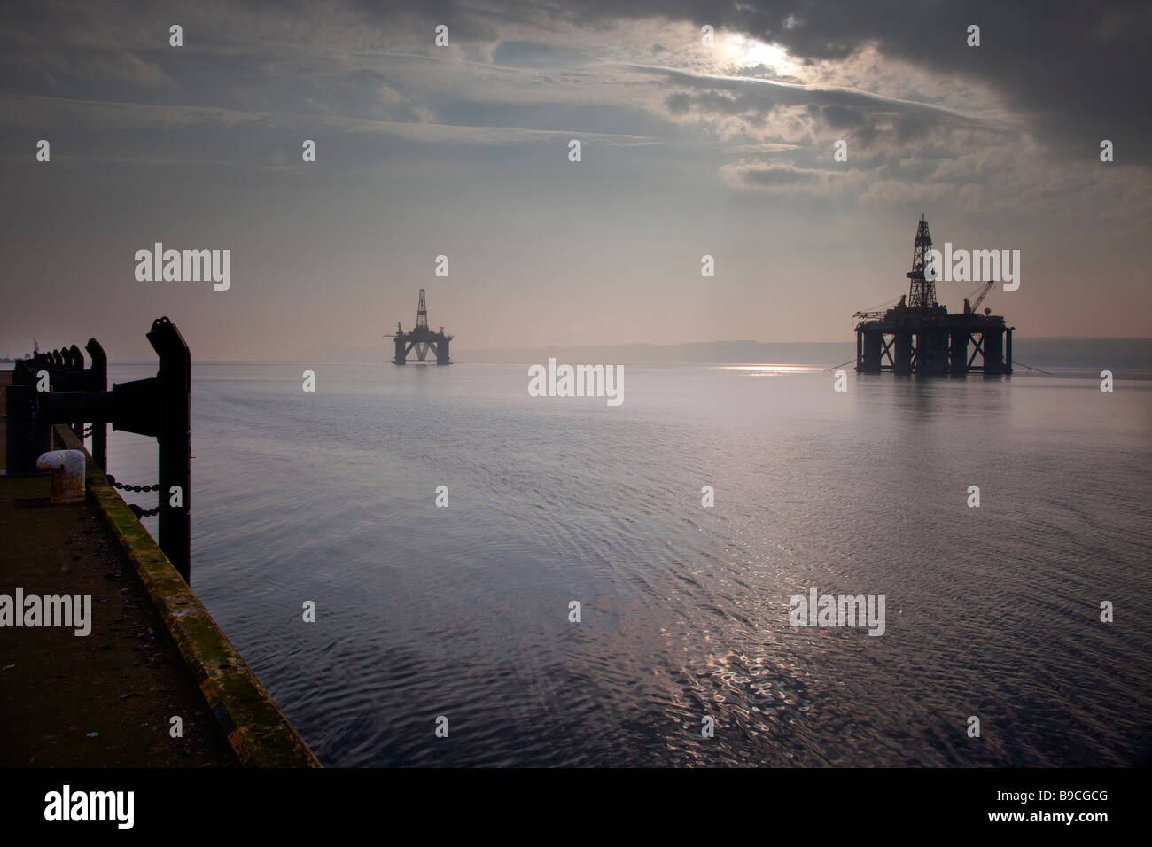 Two north-sea Scottish Oil Rigs moored at the Port of Invergordon, Cromarty Firth in Northern Scotland, UK - Stock Image