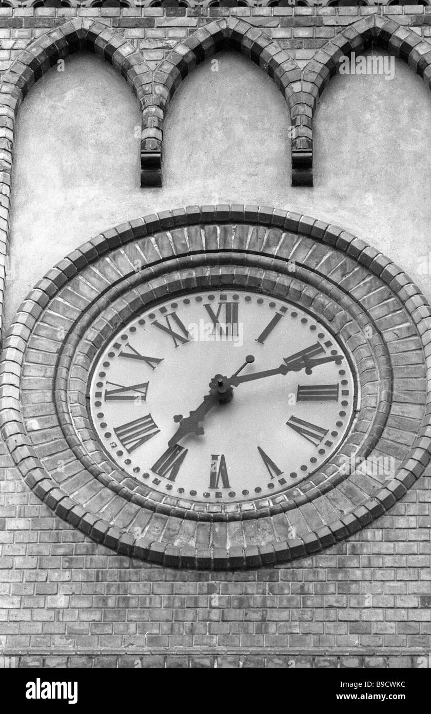 An antique clock on the Latvian Academy of Arts building - Stock Image