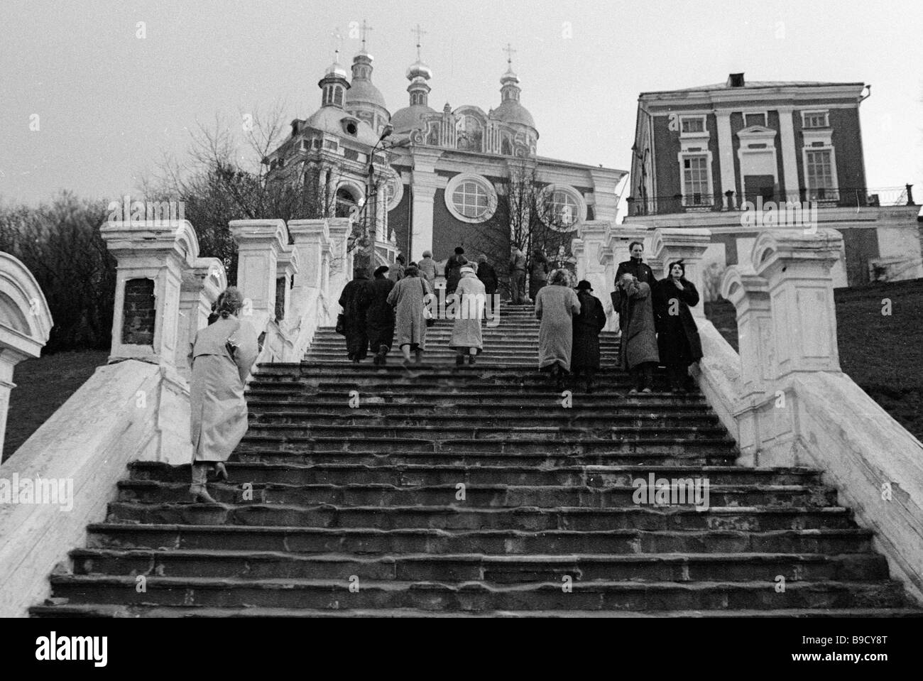 City dwellers and guests walking up the granite stairway to the architectural complex on the Cathedral Hill of the - Stock Image