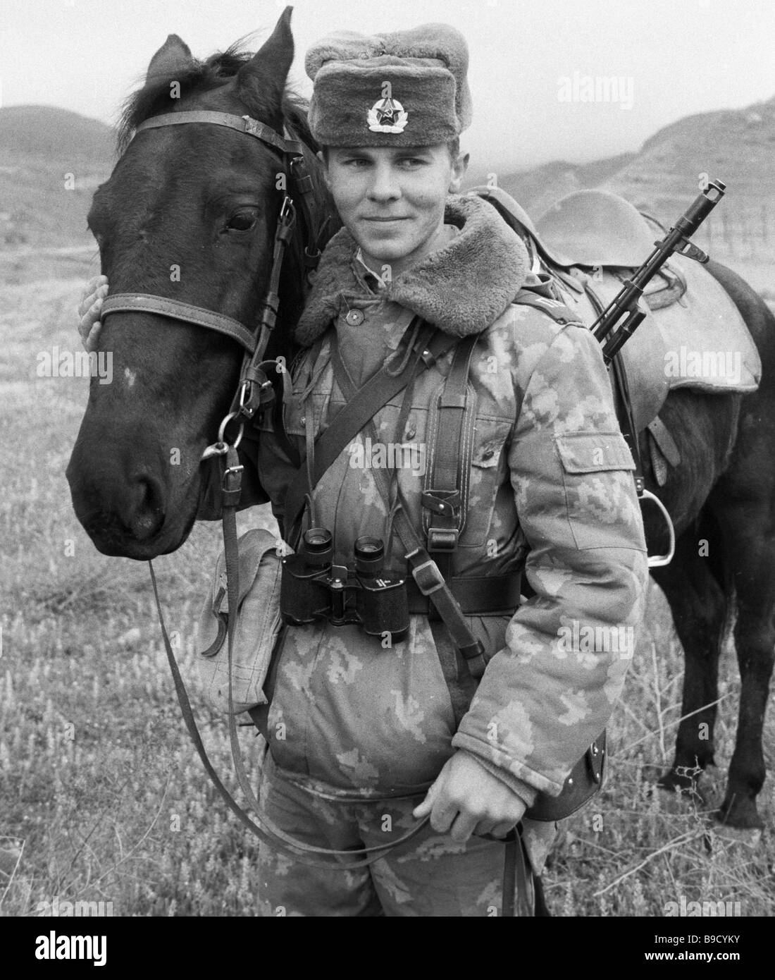 Central Asian Border District cavalry rifleman Alexander Sorzhin and his horse Spesivy - Stock Image