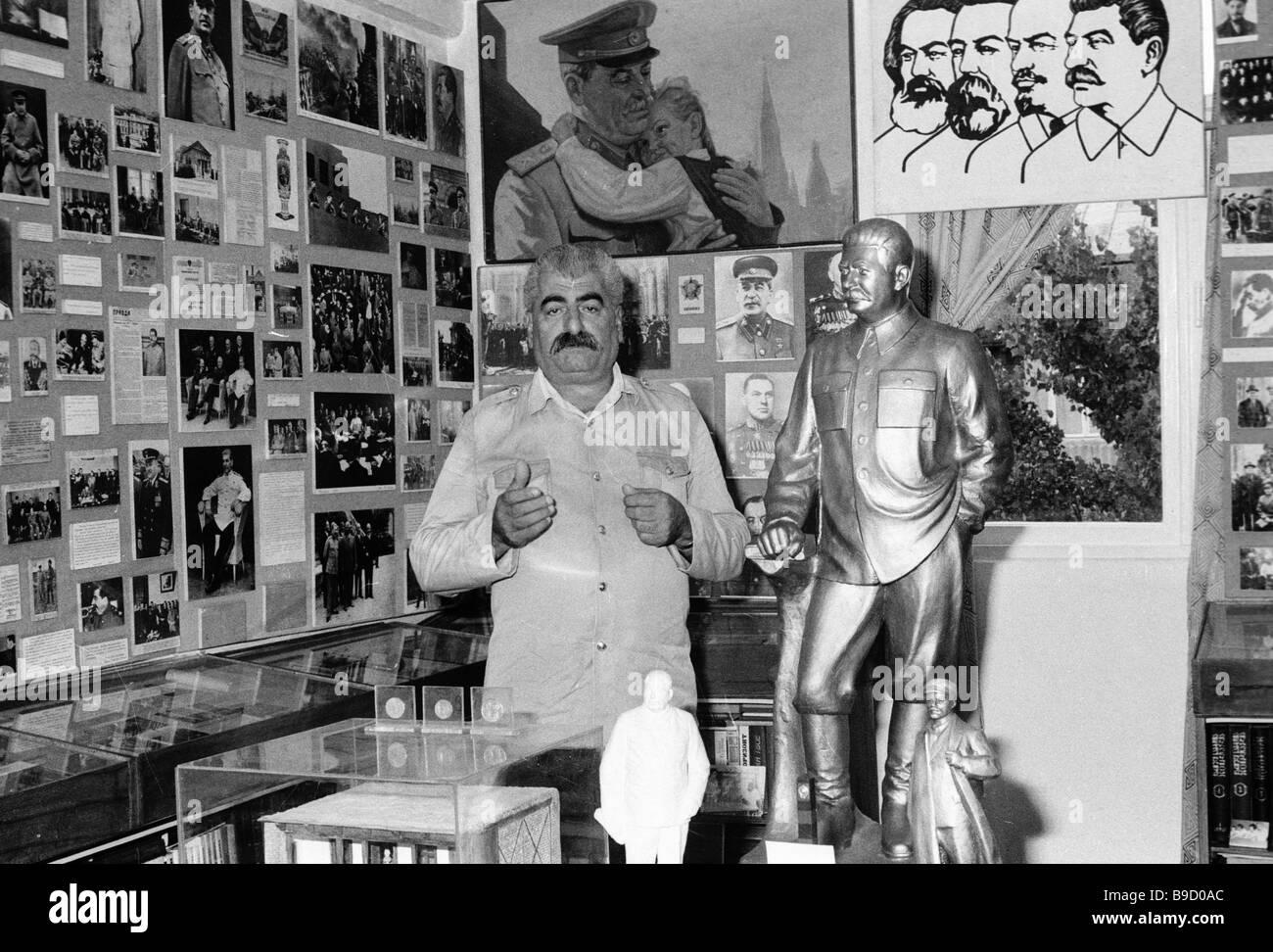 Docker Guram Kakhidze of the Batumi port among exhibits of his Stalin cult of personality museum Stock Photo