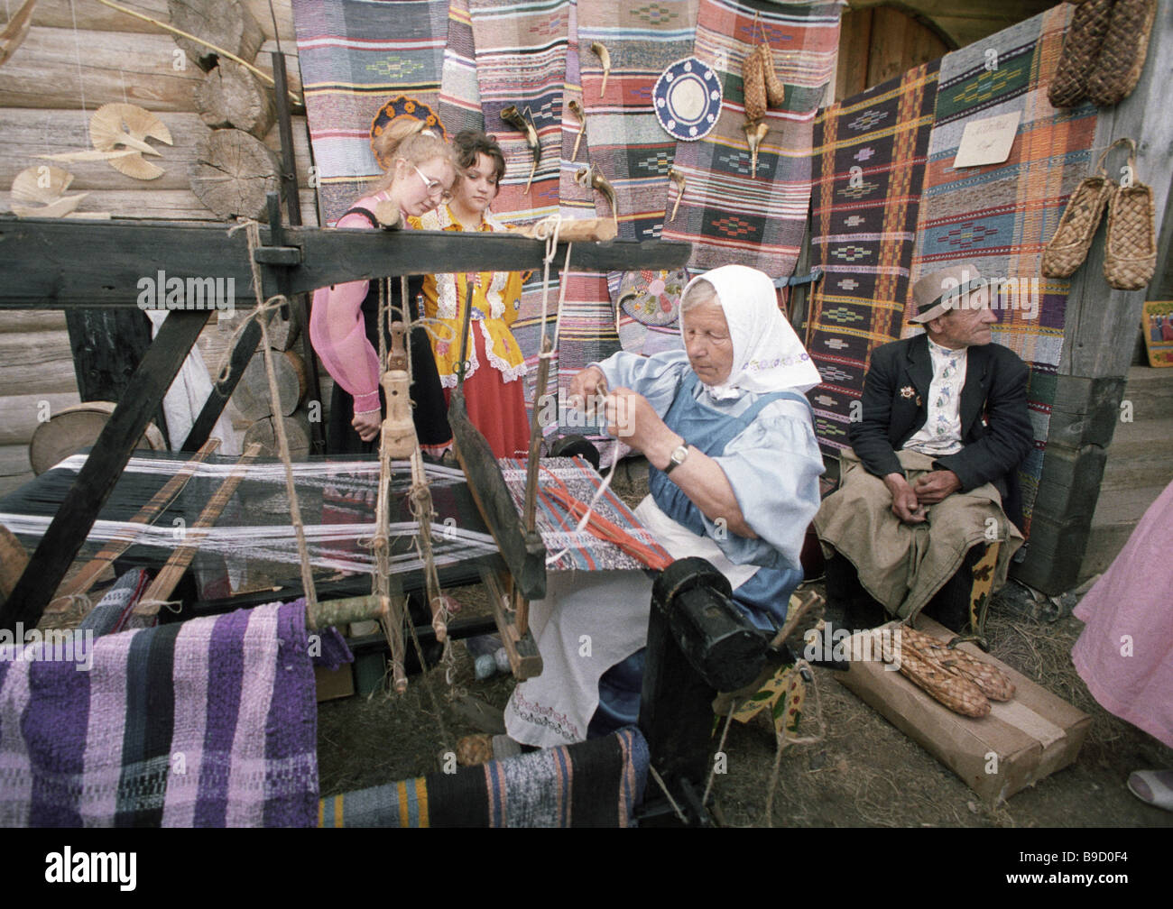 Hand spinning of linen Slavonic Literature and Culture festivities - Stock Image