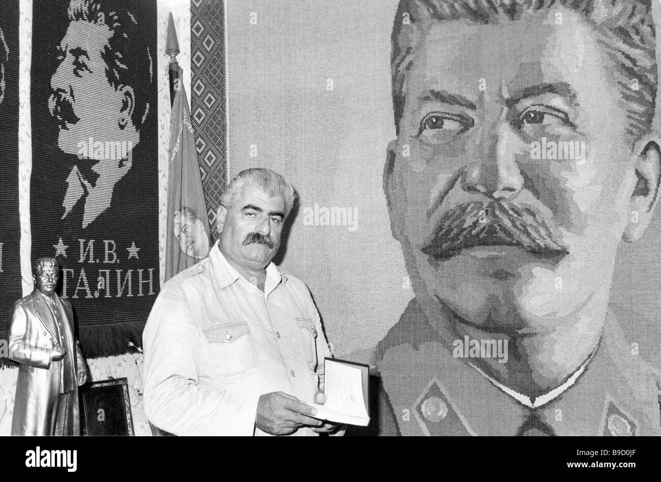 Batumi sea port dock worker Guram Kakhidze with his private collection of items related to Josef Stalin s life - Stock Image