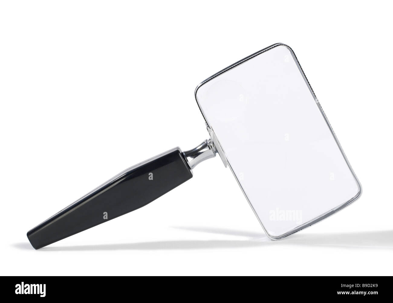 Magnify glass with black handle - Stock Image