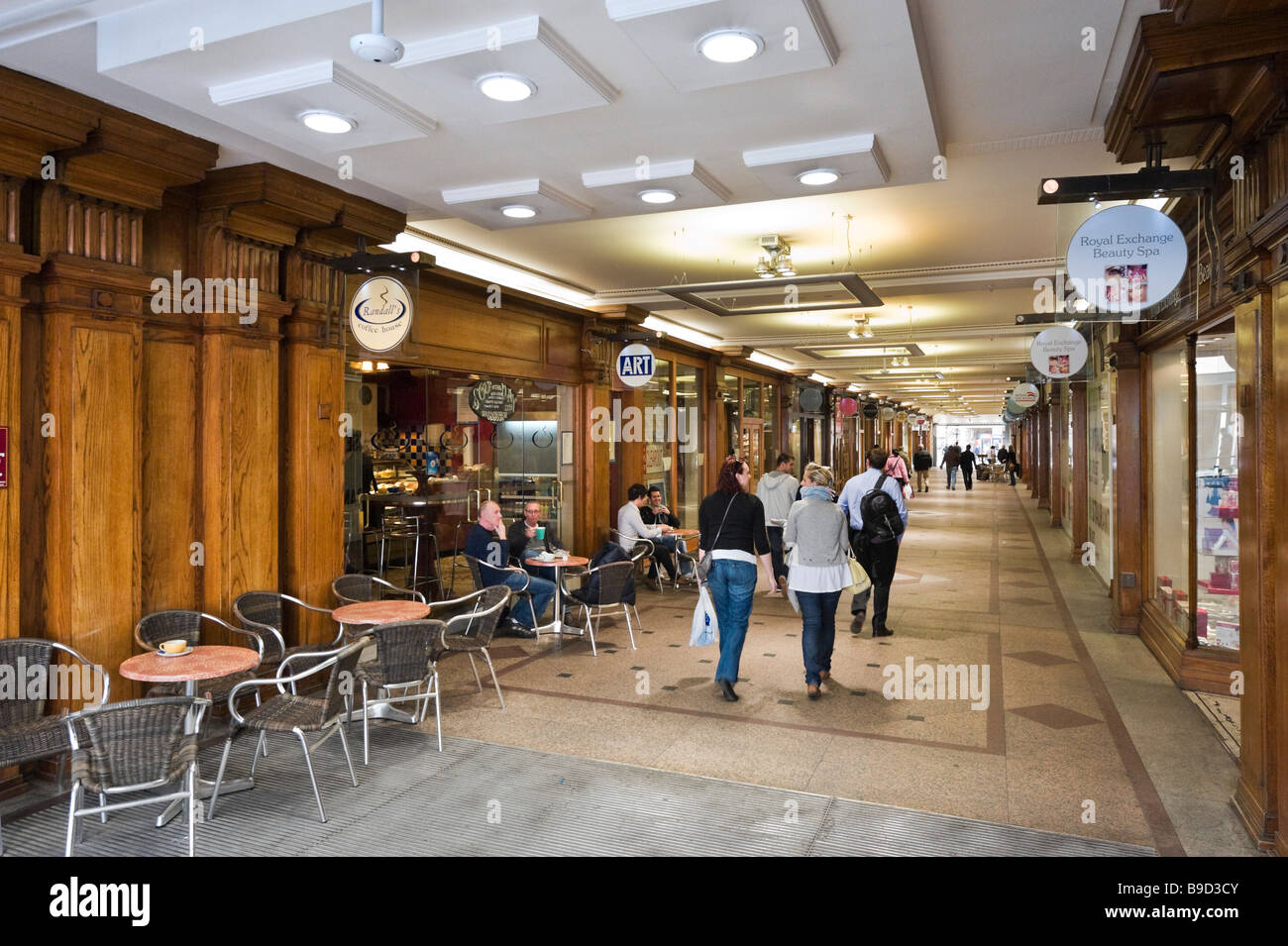 Shops and cafe in the Royal Exchange Arcade in the city centre, Manchester, England - Stock Image