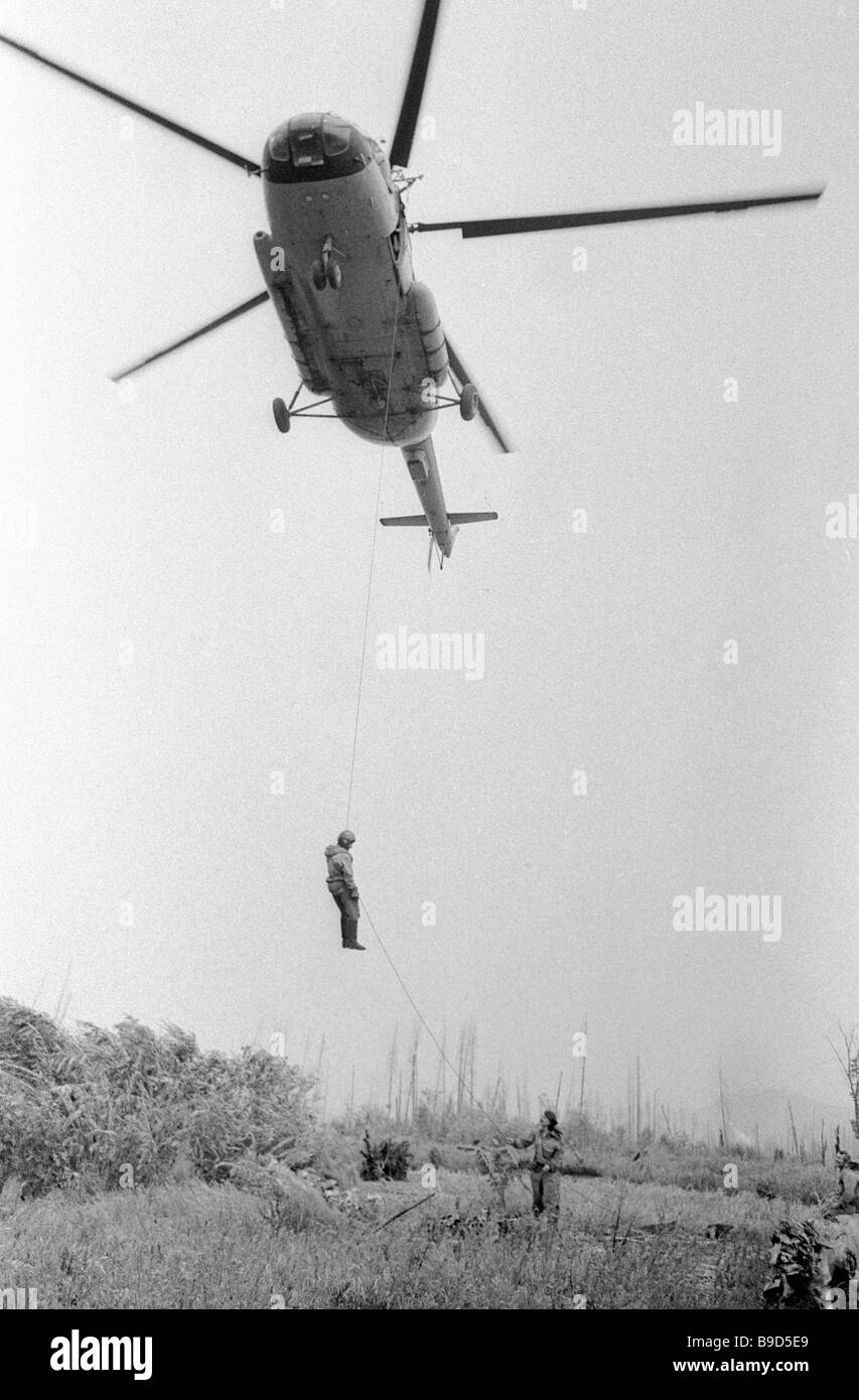 A fire crew descends on a forest conflagration site - Stock Image