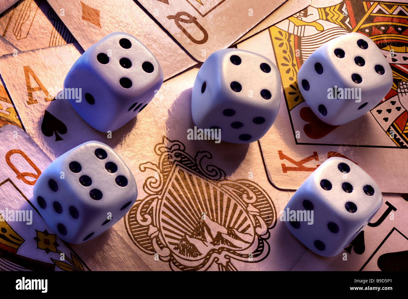 5 dice on playing cards - Stock Image
