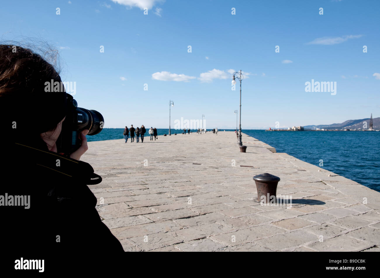 Photographer is taking picture at Trieste Molo Audace Stock Photo