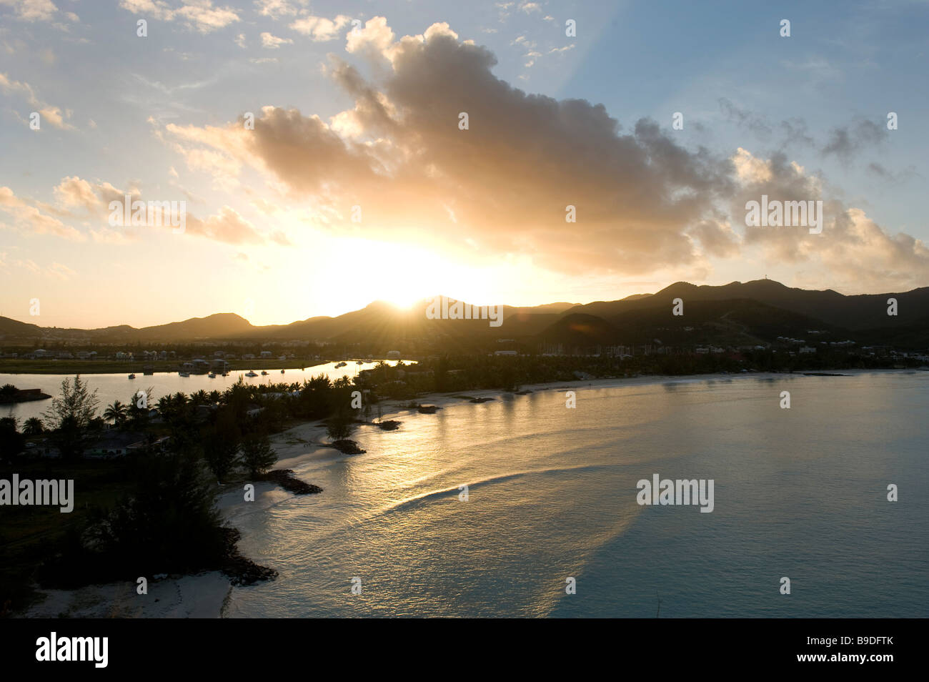 The sunrises over another of Antigua s 365 beaches here Jolly harbour on west of island on Antigua - Stock Image