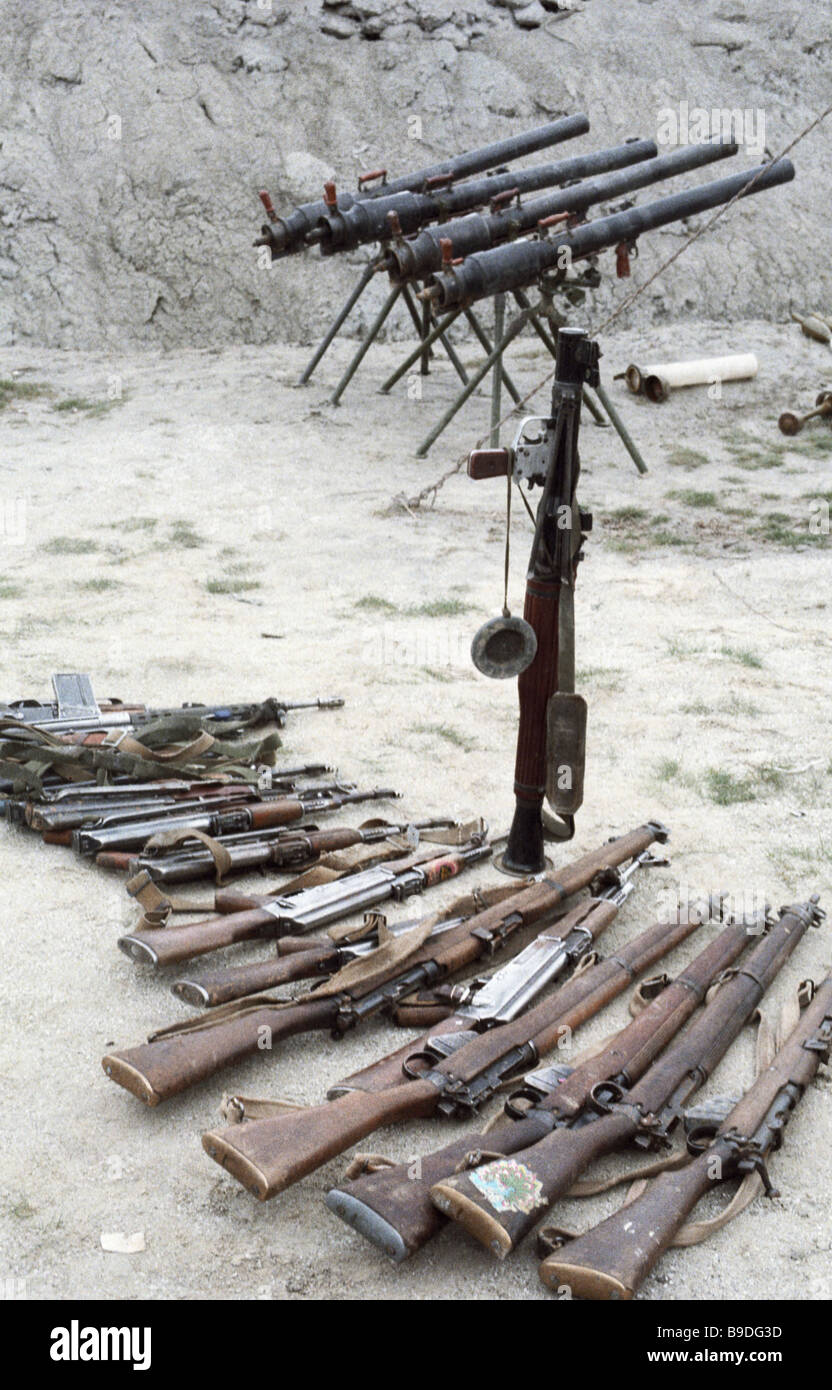 Militia captured weapons and ammunition of US Italian and Pakistani make - Stock Image