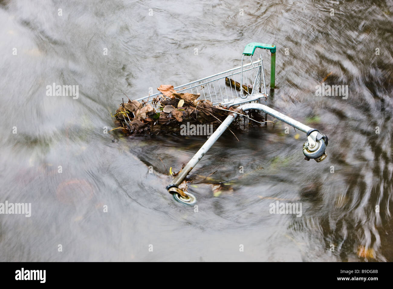 United Kingdom Discarded Shopping Trolley in A River - Stock Image