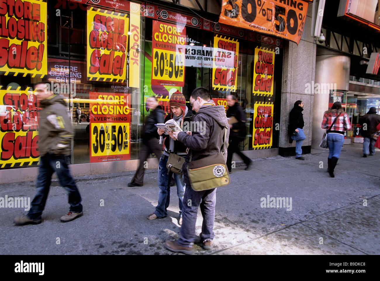 Map Of New York For Sale.New York Going Out Of Business Sale Tourists Looking At Map On The