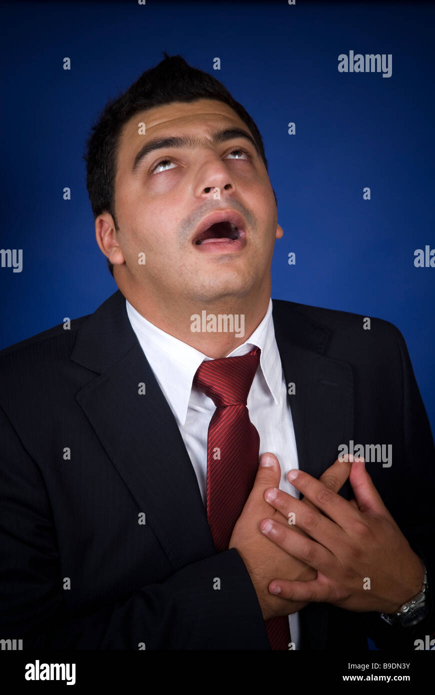 Business man having a heart attack - Stock Image