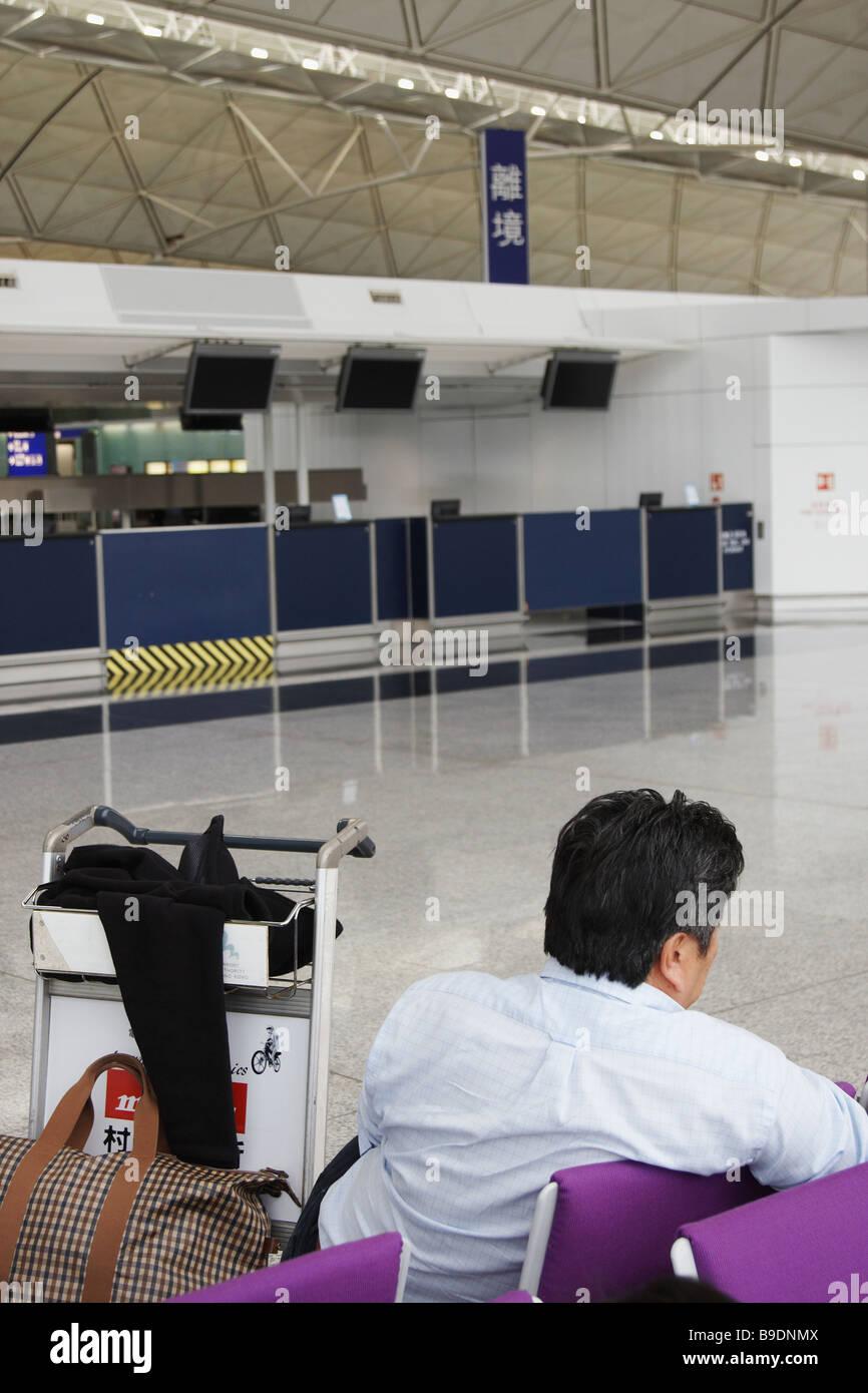 Man Waiting At Chek Lap Kok International Airport, Hong Kong - Stock Image