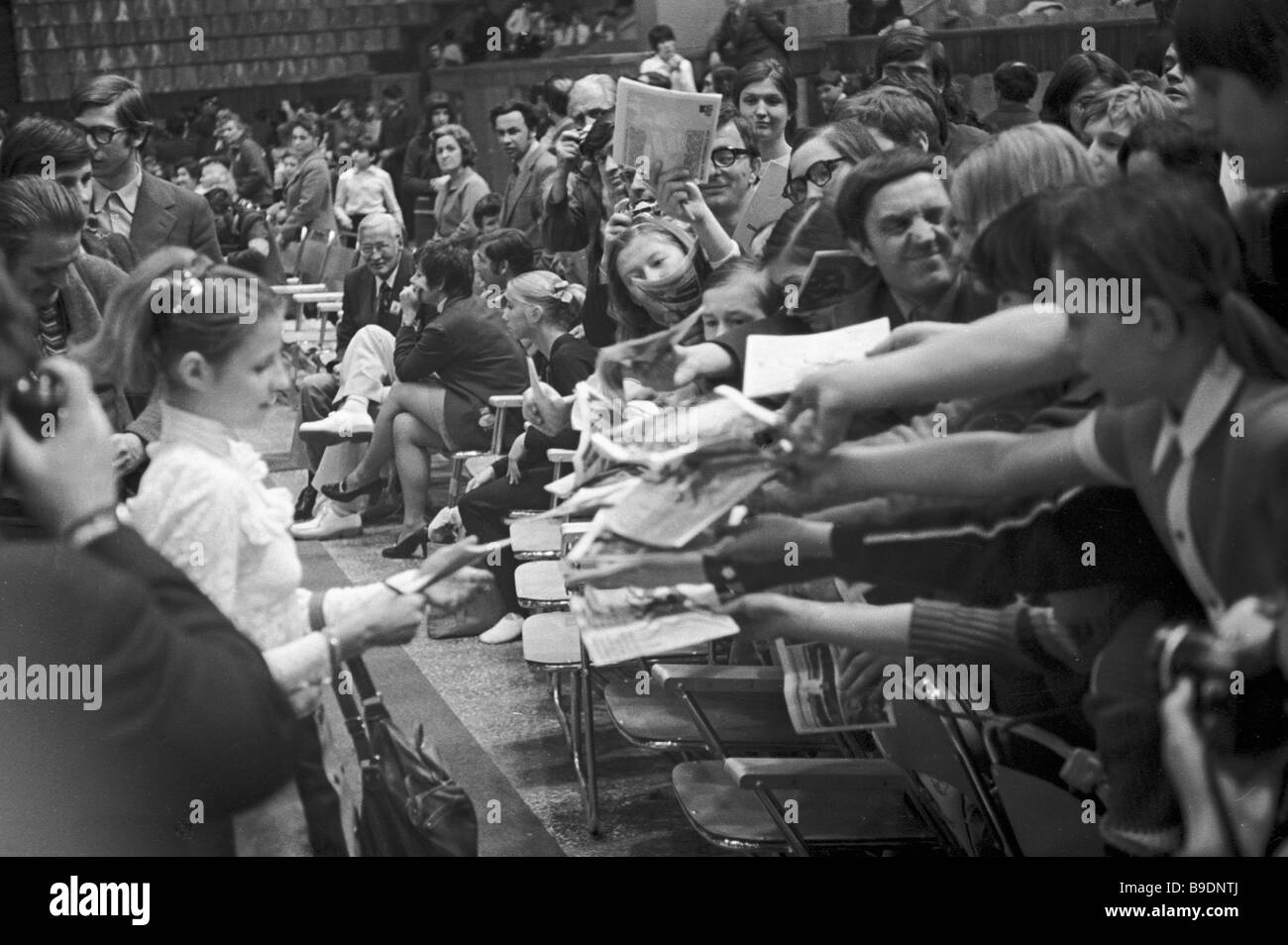 The USSR Merited Master of Sport Olga Korbut photographing to spectators and newsmen at the international artistic - Stock Image