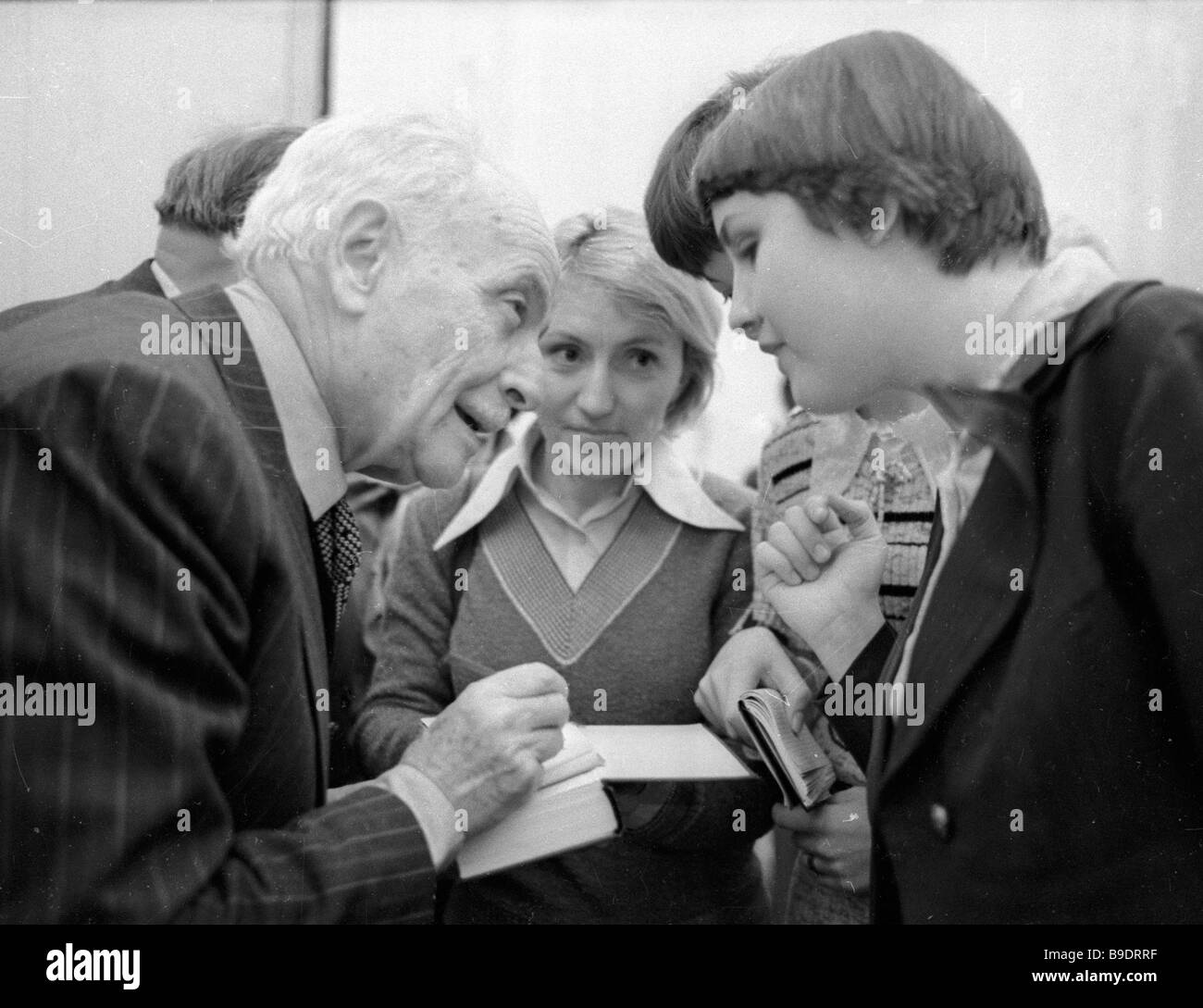French writer Louis Aragon left signing his books - Stock Image