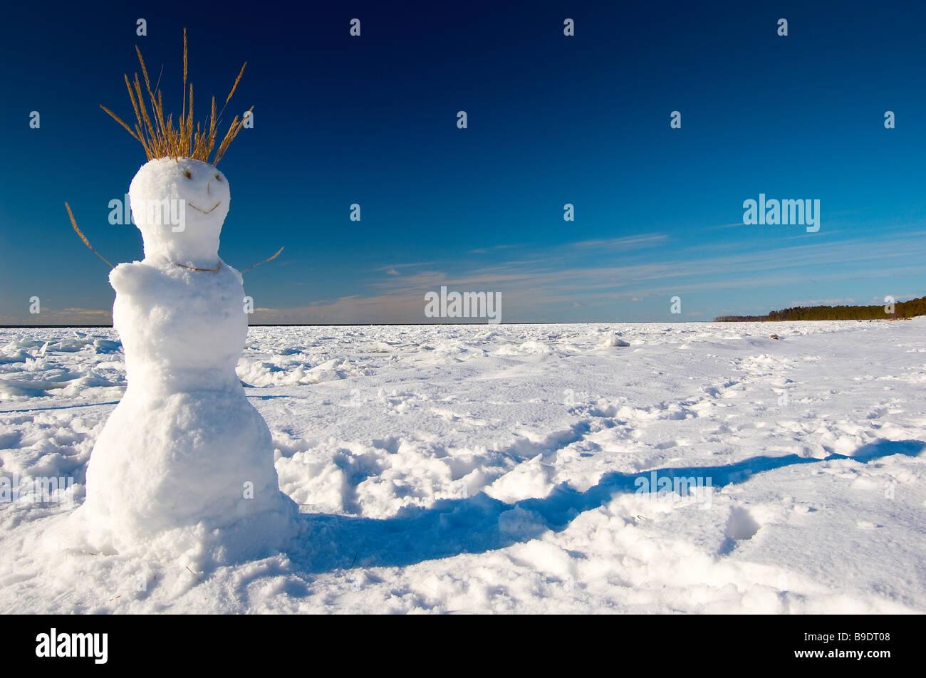 Snowman on the winter beach - Stock Image