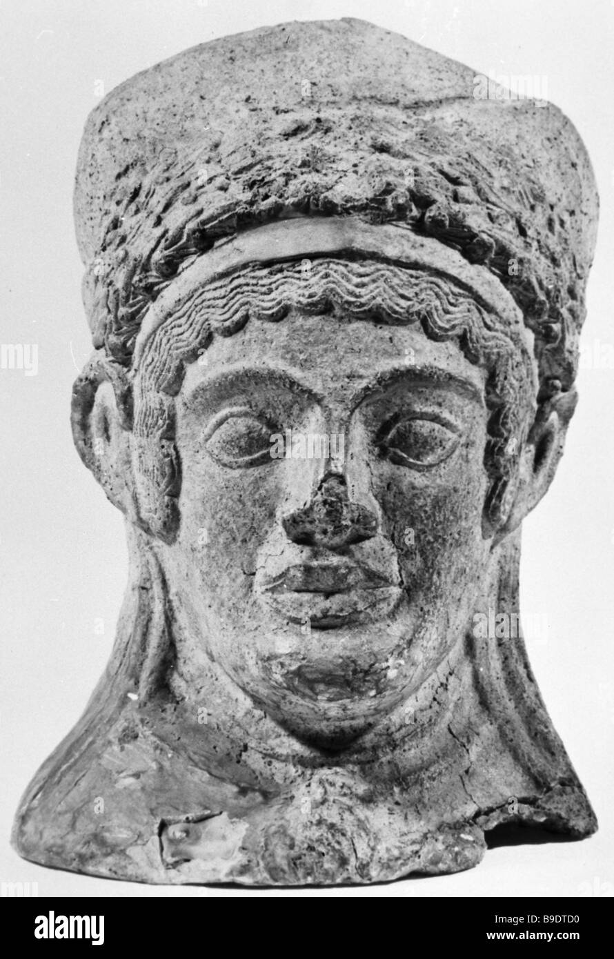 Clay votive object in the shape of a woman s head 5th century BC from the collection of the State Hermitage Museum - Stock Image