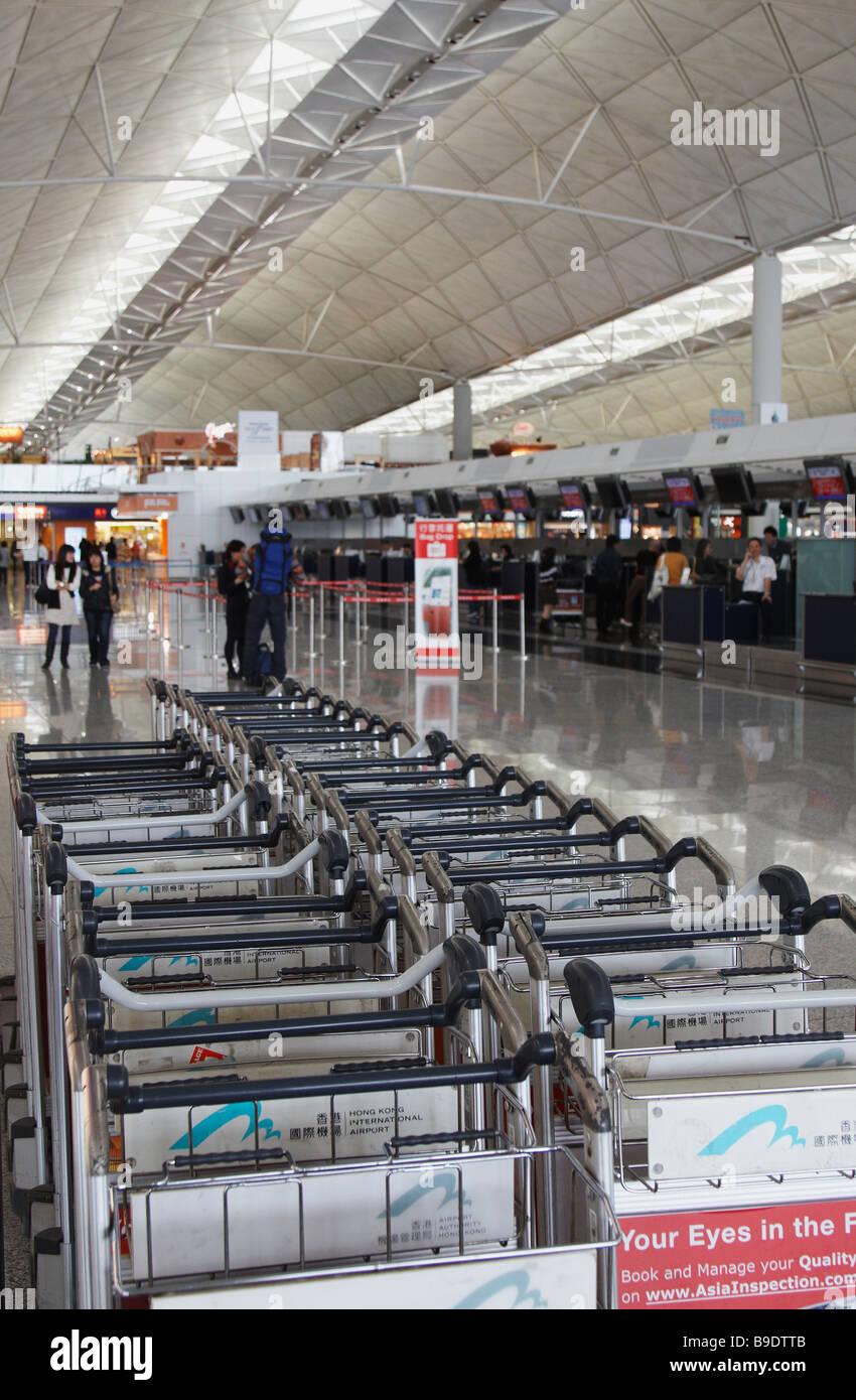 Luggage Trolleys At Chek Lap Kok International Airport, Hong Kong - Stock Image