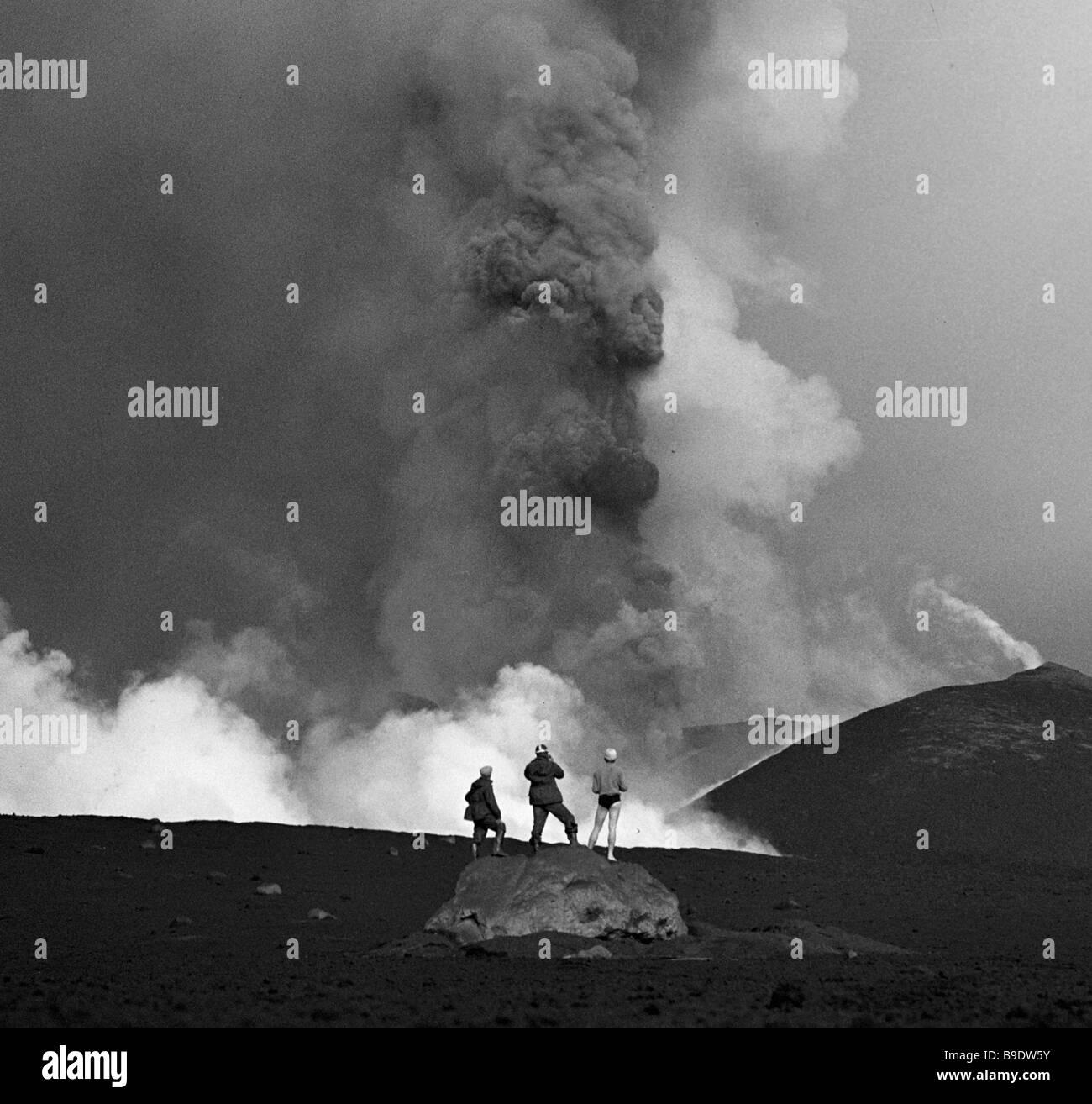 Volcanologists watching fumaroles - Stock Image