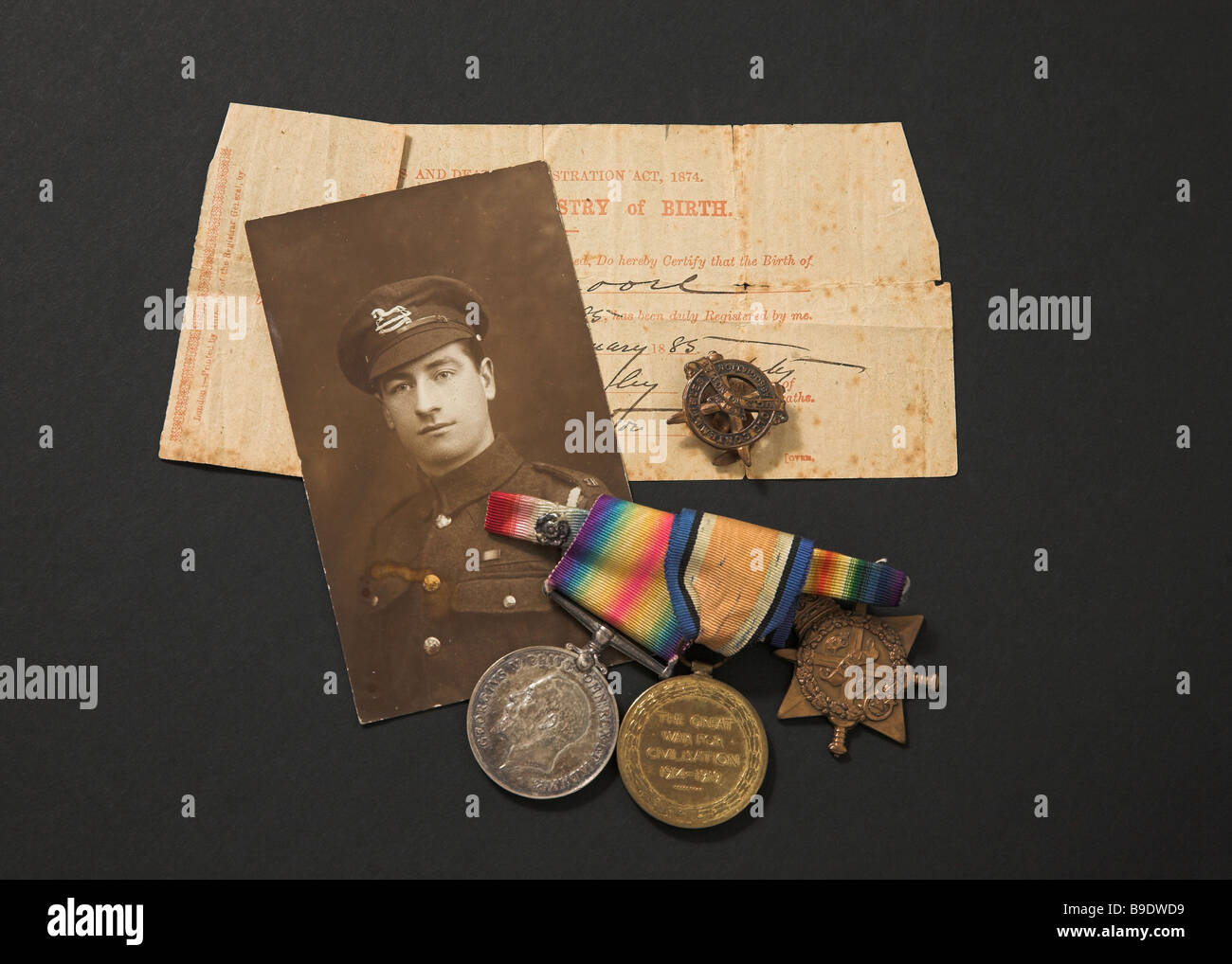 Great War memorabilia photograph medals and birth certificate - Stock Image