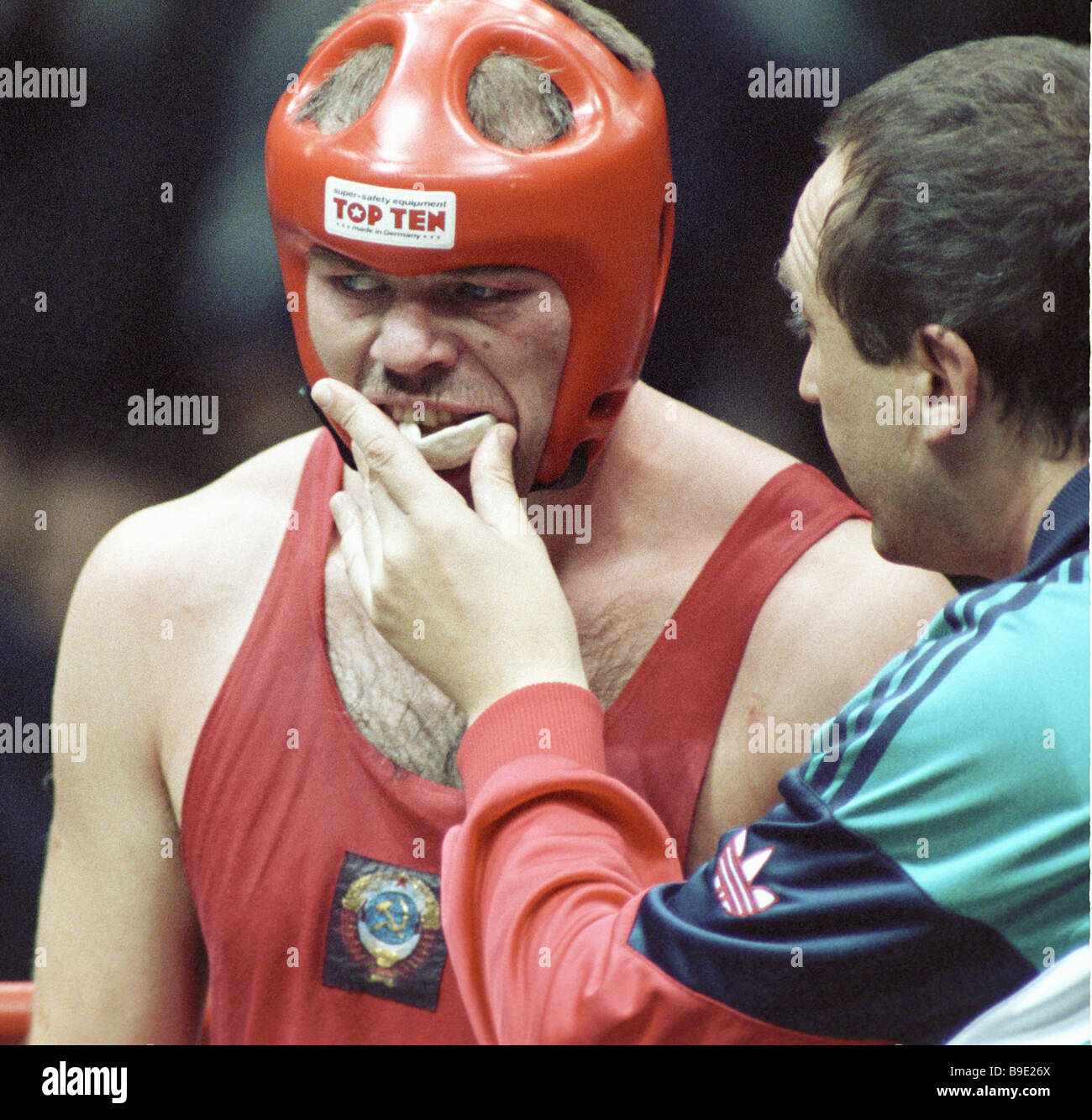 Coach takes the mouthpiece from the boxer Sudakov silver prizewinner in the up to 91 kg weight category at the World - Stock Image