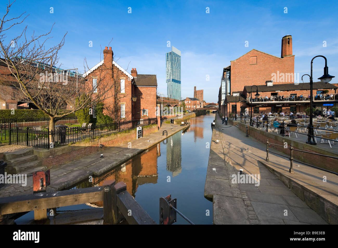 Cafe and bar in the redeveloped canalside area of Castlefield with the Beameth Tower in the distance, Manchester, - Stock Image