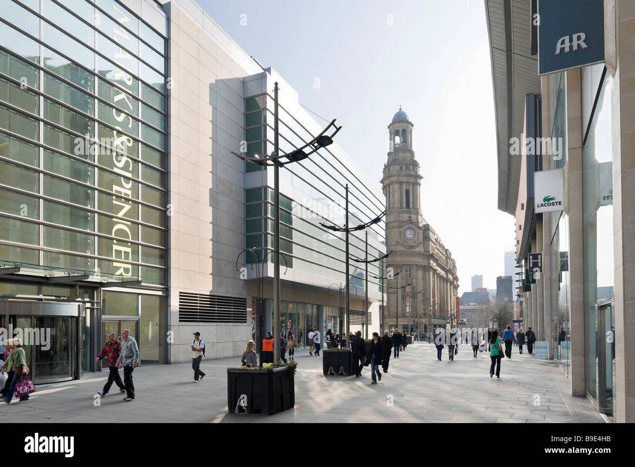 Major shops and department stores on New Cathedral Street looking towards the Royal Exchange Theatre, Manchester, - Stock Image