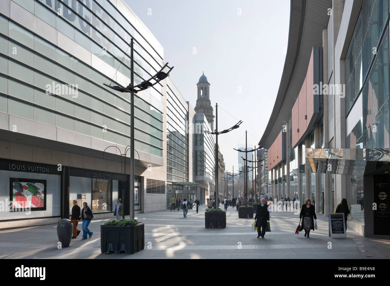 Major shops and department stores on New Cathedral Street in the city centre, Manchester, England - Stock Image