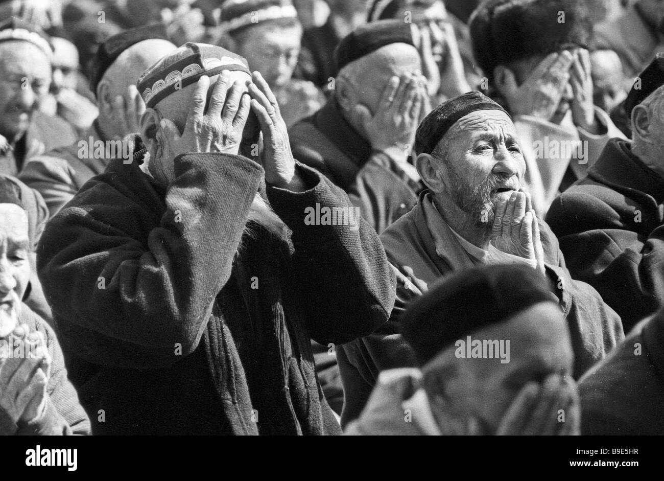 Muslims praying in the mosque Tashkent - Stock Image