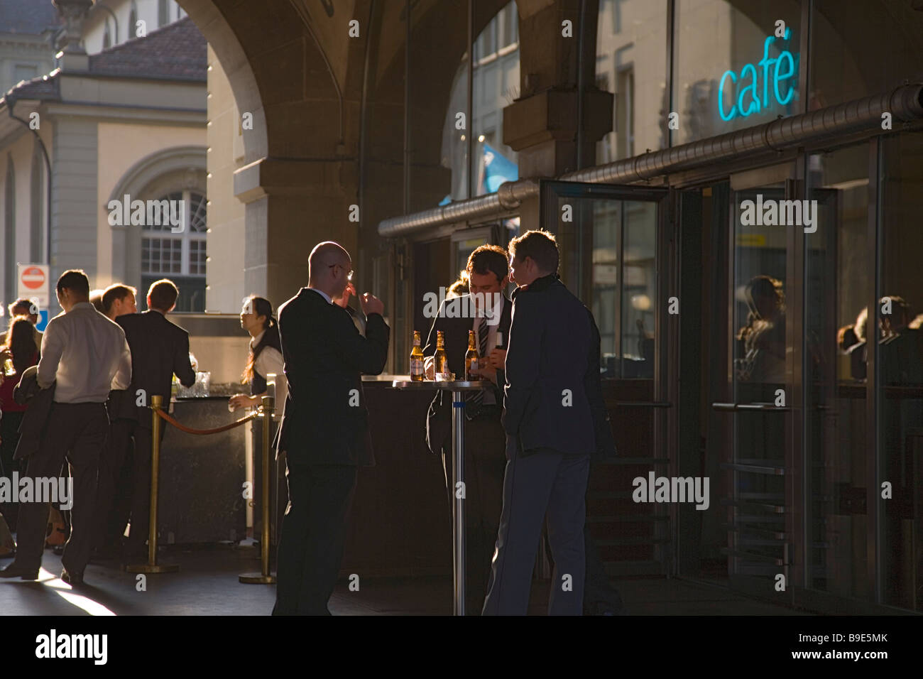 Businessmen having a beer outside the restaurant Kornhaus Old Town Berne Canton of Berne Switzerland - Stock Image