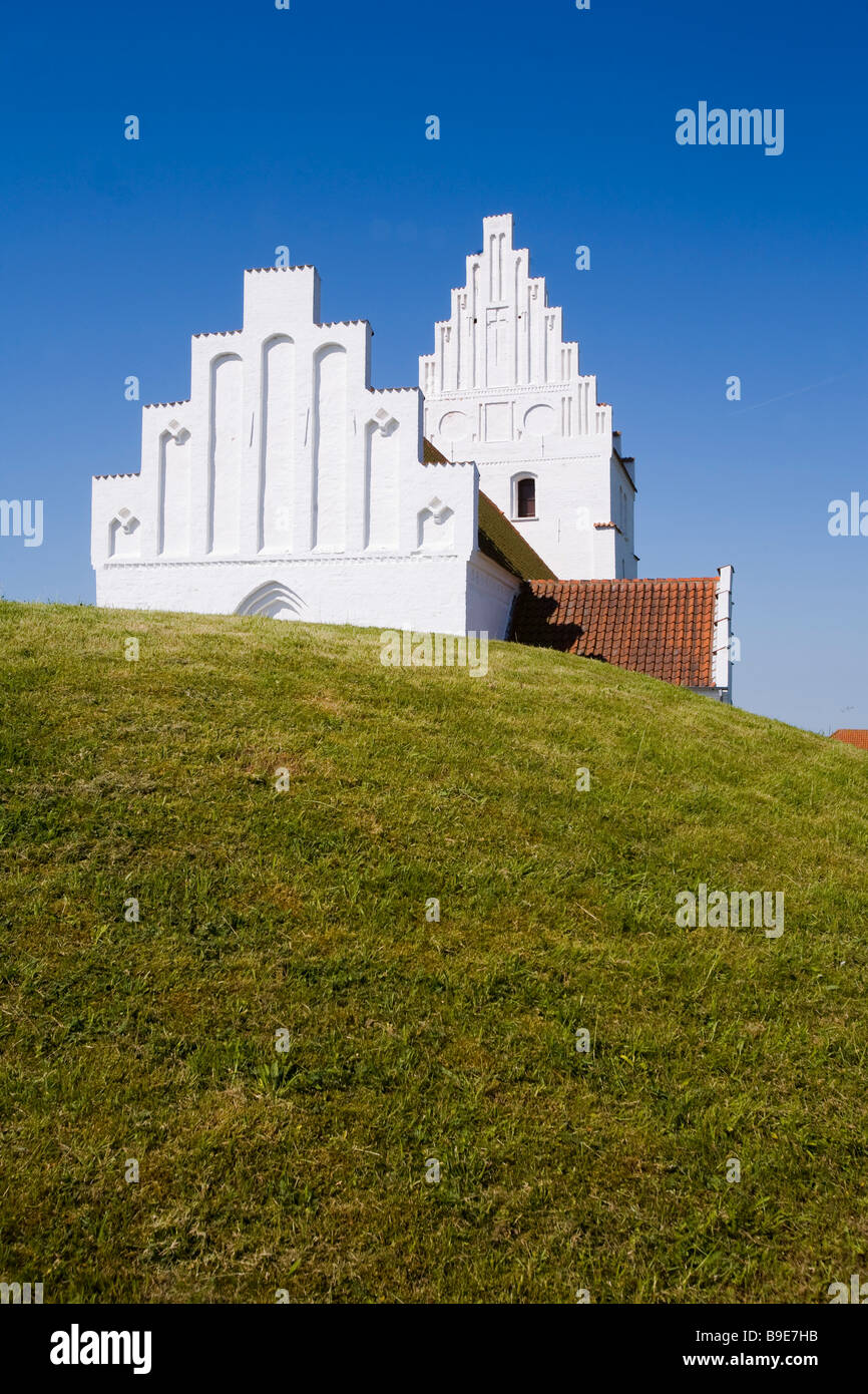 Denmark Zealand Møn island Hijertebjerg Kirkegardsudvalged church with burial mound Stock Photo