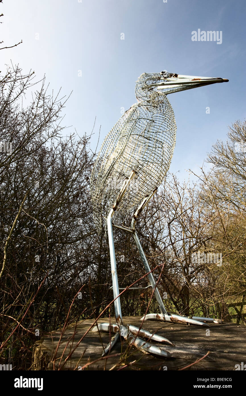 Standing tall at Rutland Water nature reserve,a bird made form recycled metal. - Stock Image
