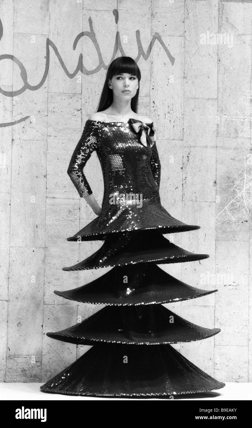 A model on the catwalk demonstrating an original dress from the latest Pierre Cardin collection at the French designer - Stock Image
