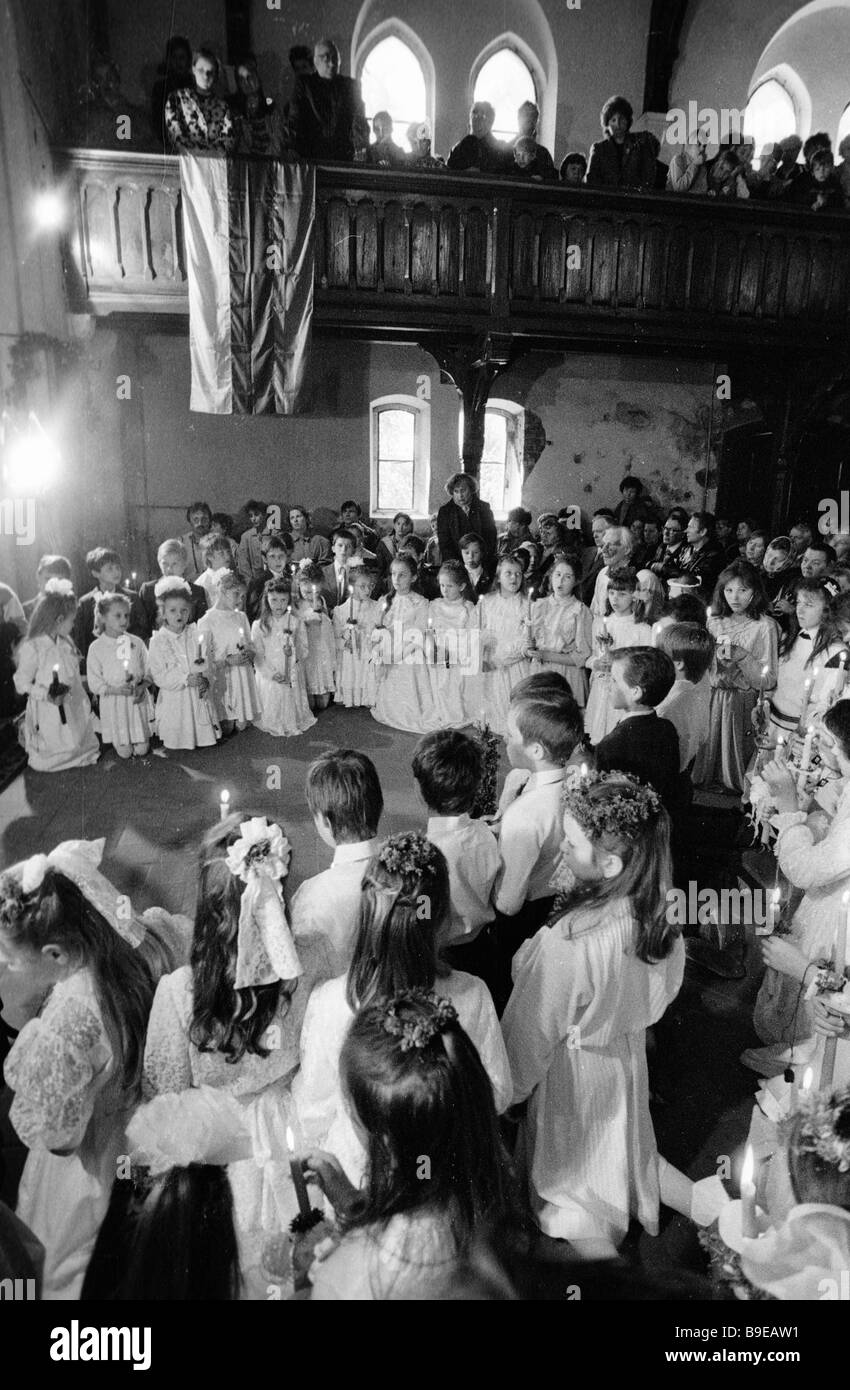 Children recite excerpts from the Scripture during confirmation in a Roman Catholic church - Stock Image