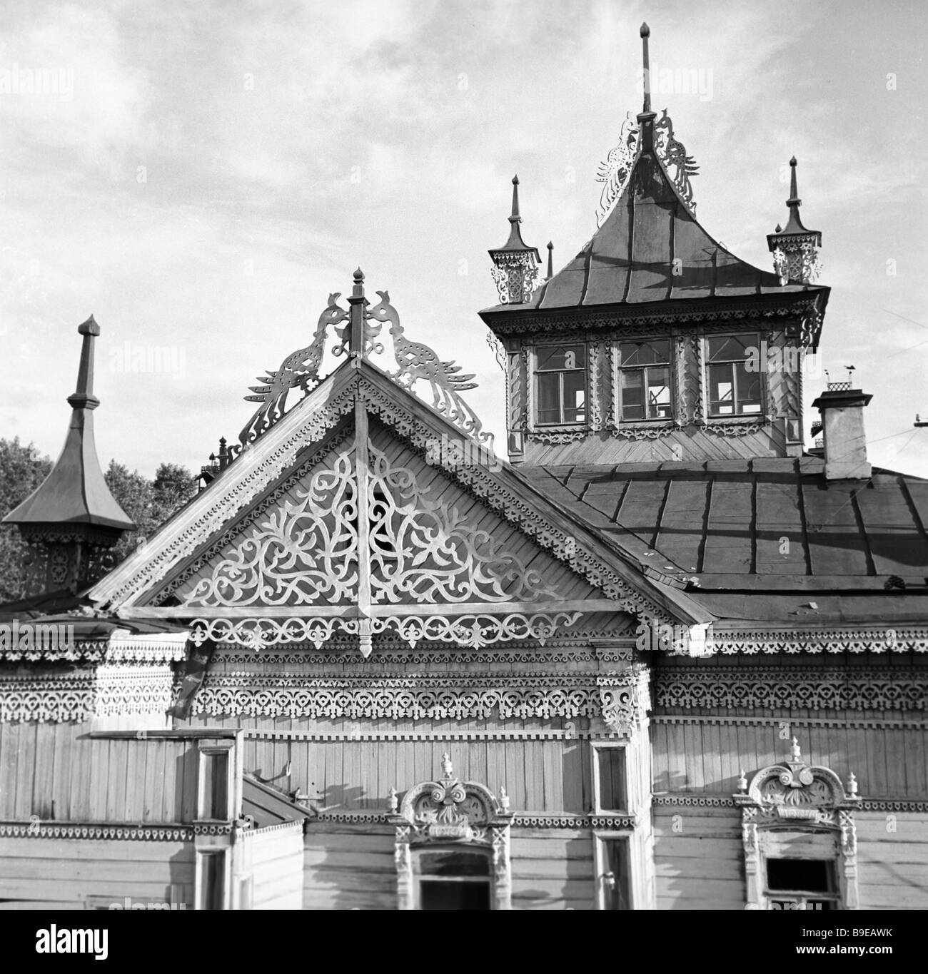 Houses adorned with openwork of abstract firebirds spires and marquees - Stock Image