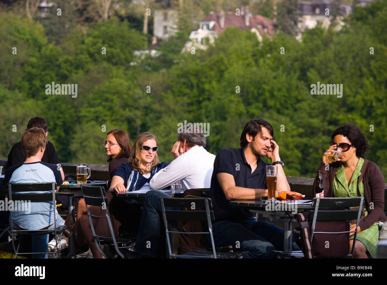 Guests sitting in a the restaurant at Münsterplattform terrace near Münster of Berne Old Town Berne - Stock Image