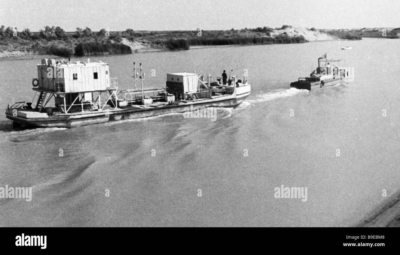 Ships plying the V I Lenin Kara Kum Canal - Stock Image