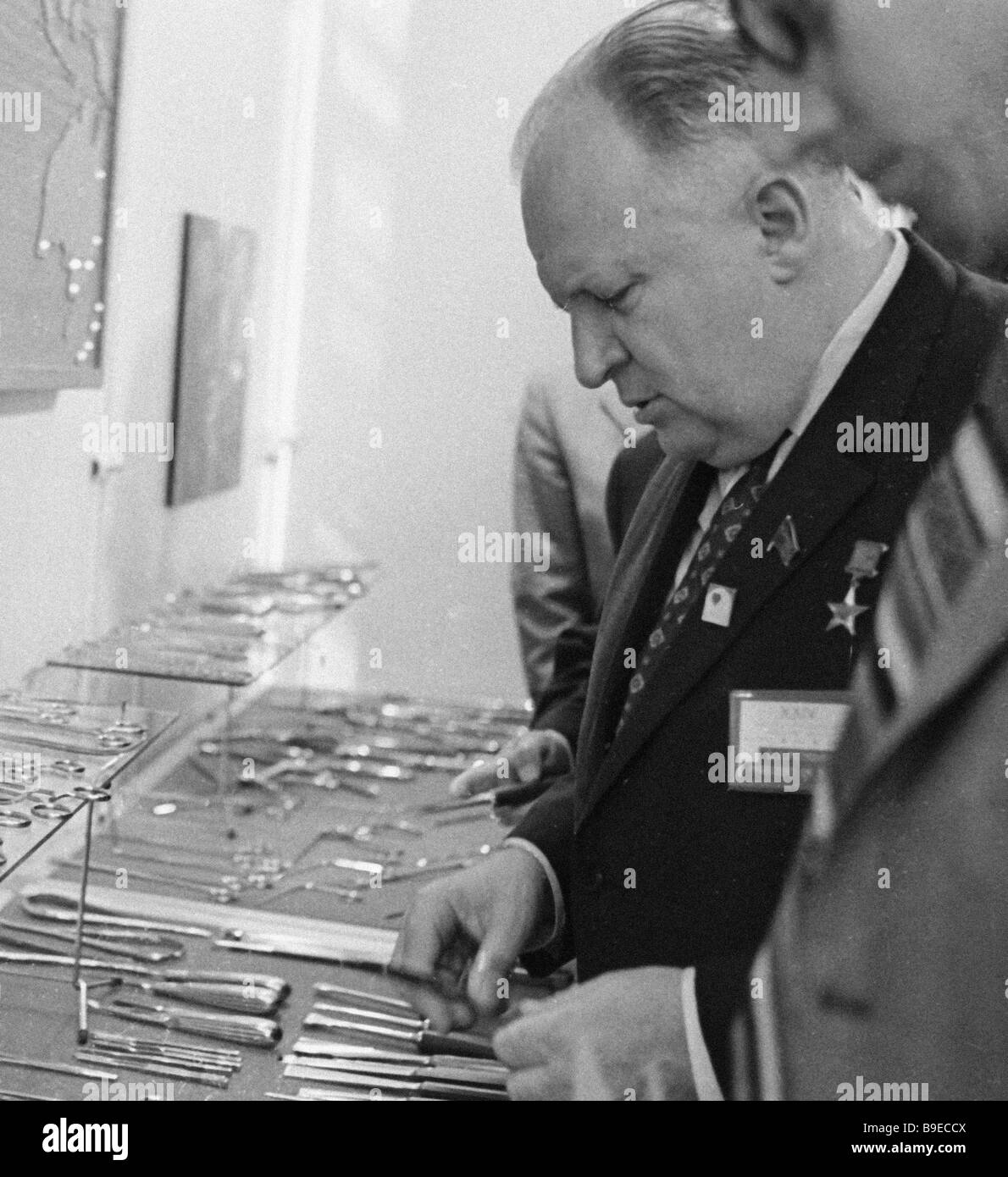 Soviet Minister of Health surgeon Boris Petrovsky examines the showpieces at Surgery 71 exhibition - Stock Image
