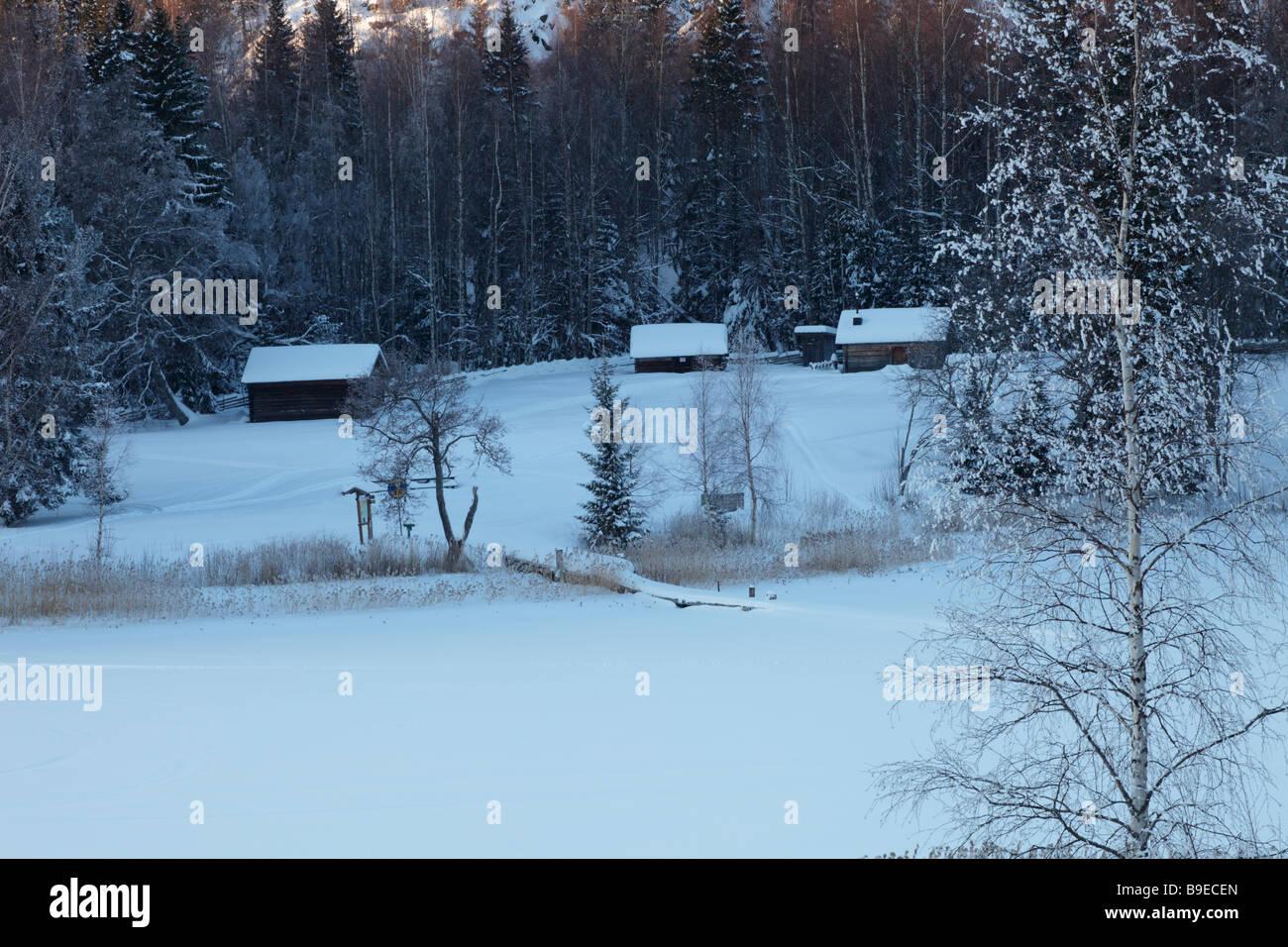 Farm-houses in winter. Rural landscape in the UNESCO World Heritage area Hoega Kusten / High Coast in Sweden - Stock Image