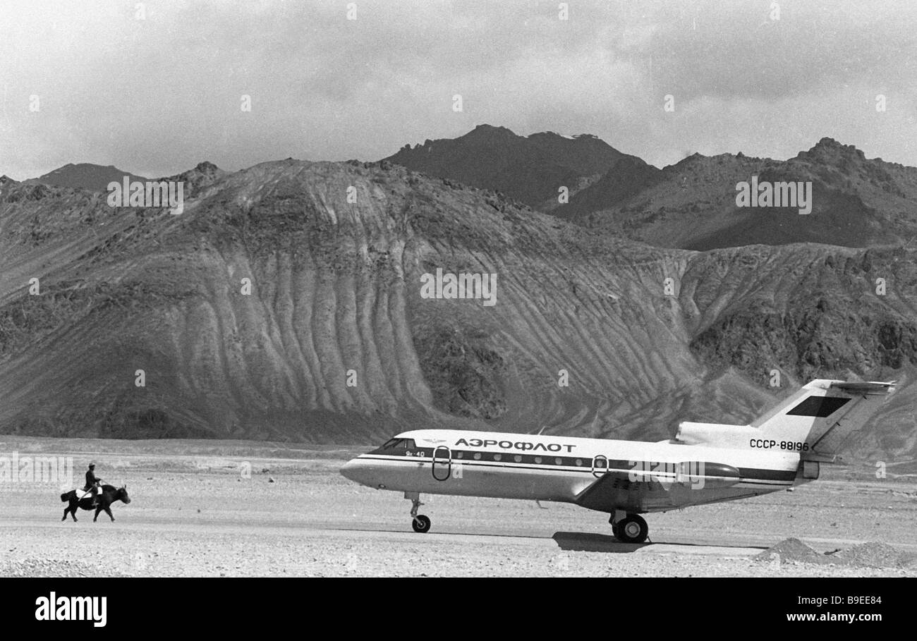 A Yak 40 jet liner parked at Murgab airport - Stock Image