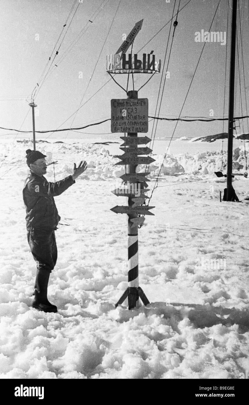 Post with indications of directions and distances Mirny Observatory Antarctica - Stock Image