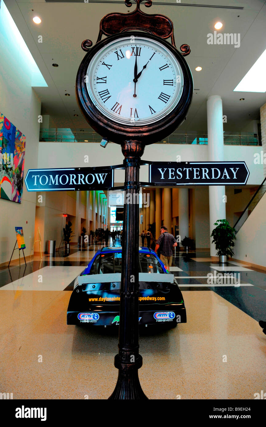 Today is yesterday s tomorrow Large clock on pole in roman numerals - Stock Image