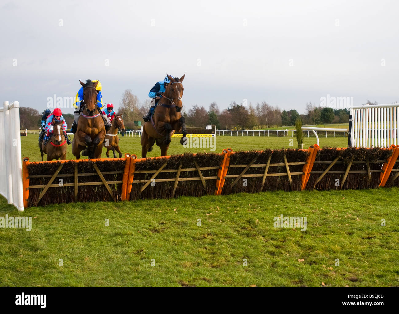 A hurdle race at Market Rasen races, Lincolnshire, England Stock Photo